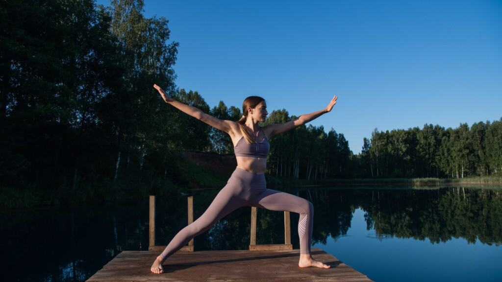 Doing Yoga In The Morning By The Lake