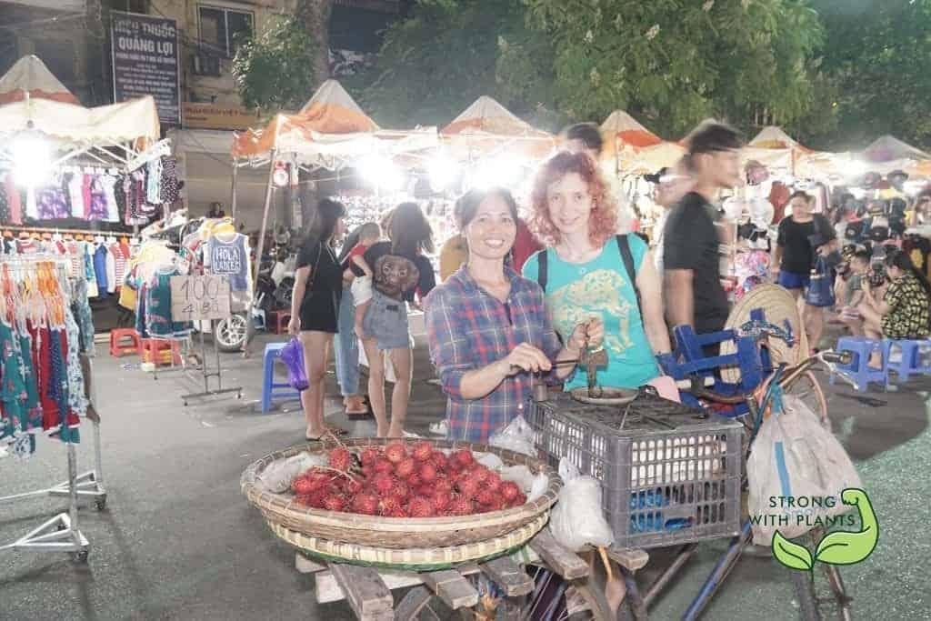 Purchasing Some Rambutan In The Night Market
