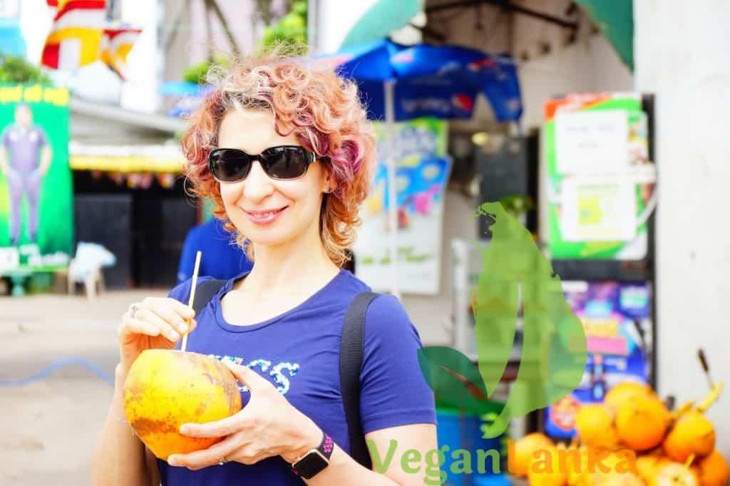 Tasting the distinctive sweet taste of King Coconut water
