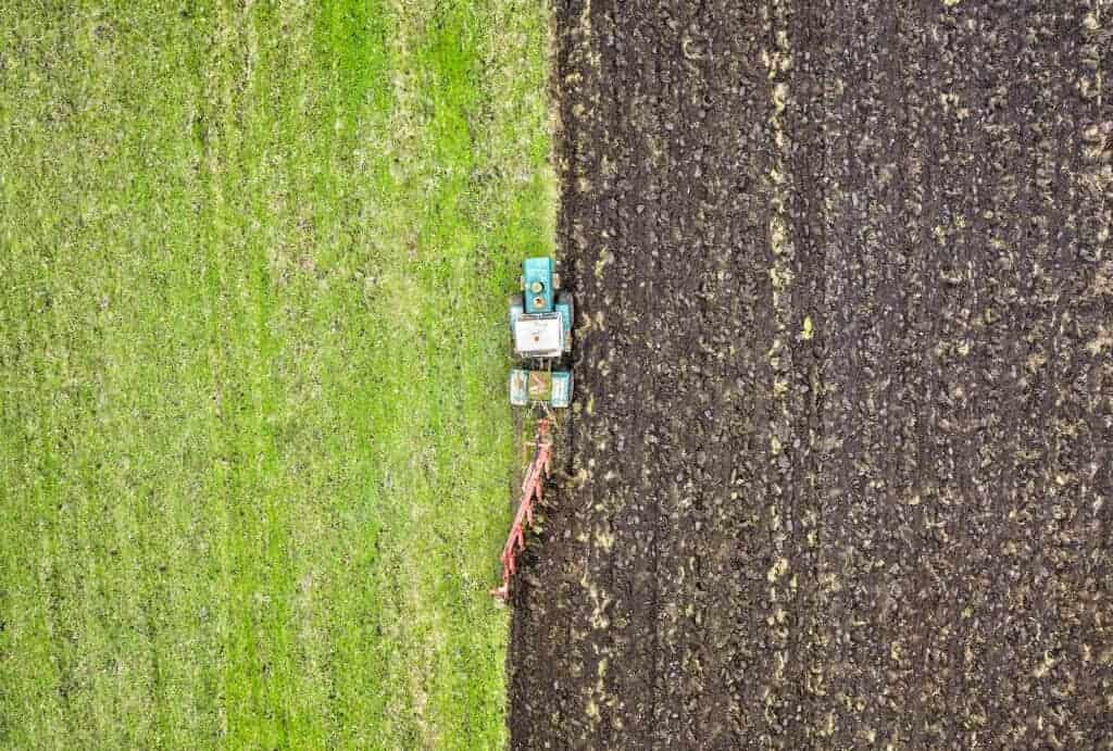 The Future of Tech is Vegan: Tractor working in field.